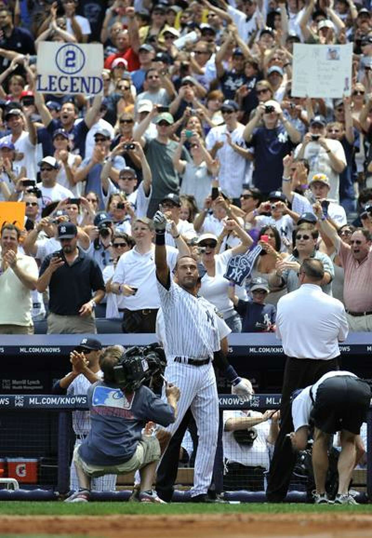 New York Yankees Derek Jeter waves to the cheers of the crowd after he hit a solo home run, his 3, 000th career hit off of Tampa Bay Rays starting pitcher David Price in the third inning of a baseball game on Saturday, July 9, 2011 at Yankee Stadium in New York. (AP Photo/Kathy Kmonicek)
