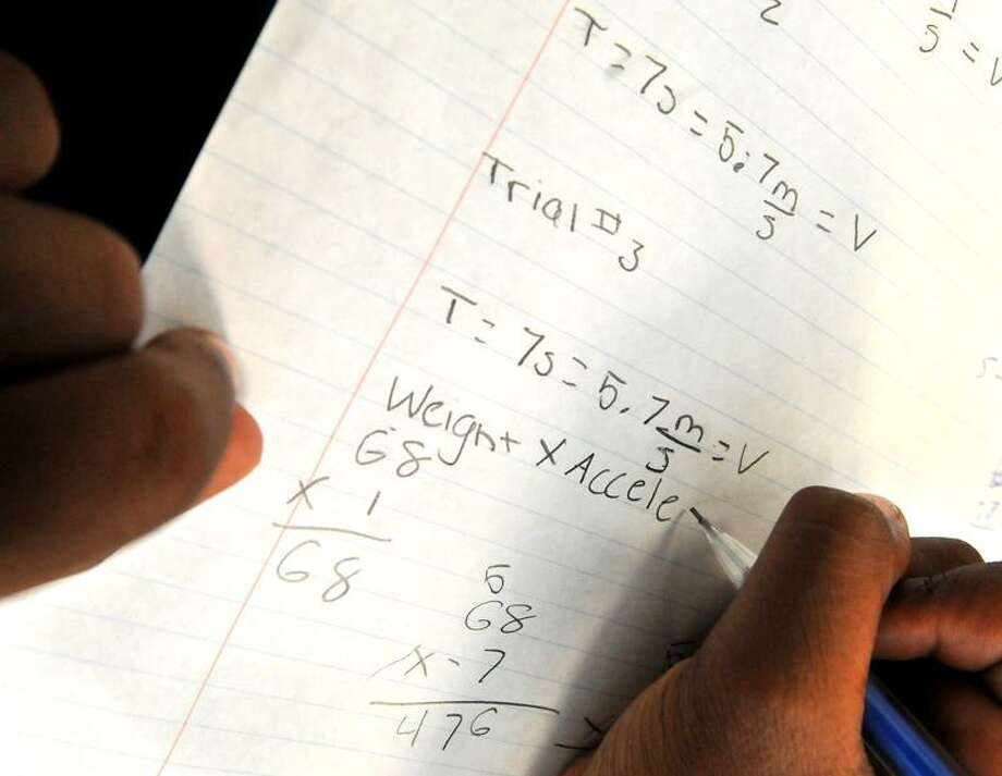 Students participating in a LEAP program work on a physics formula. Brad Horrigan/Register