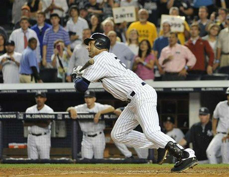 New York Yankees' Derek Jeter grounds out to end the baseball game against the Tampa Bay Rays on Thursday, July 7, 2011, at Yankee Stadium in New York. Tampa Bay won 5-1. (AP Photo/Kathy Kmonicek) Photo: AP / FR170189 AP