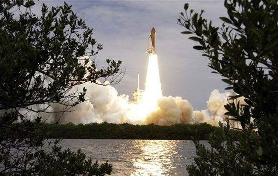 The space shuttle Atlantis lifts off from the Kennedy Space Center Friday, July 8, 2011, in Cape Canaveral, Fla. Atlantis is the 135th and final space shuttle launch for NASA. (AP Photo/Chris O'Meara) Photo: AP / AP