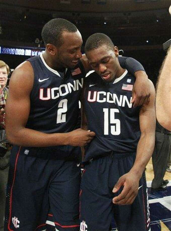 Connecticut's Donnell Beverly (2) celebrates with teammate Kemba Walker (15) after an NCAA college basketball game against Louisville at the Big East Championship Saturday, March 12, 2011, in New York.  Connecticut won the game 69-66. (AP Photo/Frank Franklin II) Photo: ASSOCIATED PRESS / AP2011