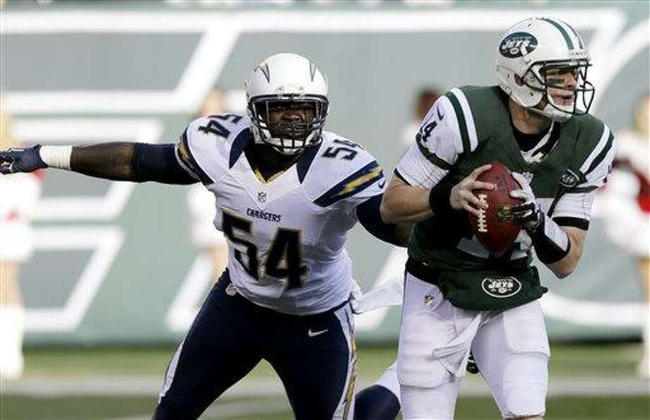 San Diego Chargers outside linebacker Melvin Ingram (54) chases after New York Jets quarterback Greg McElroy (14) during the first half of an NFL football game, Sunday, Dec. 23, 2012 in East Rutherford, N.J. (AP Photo/Kathy Willens) Photo: AP / AP