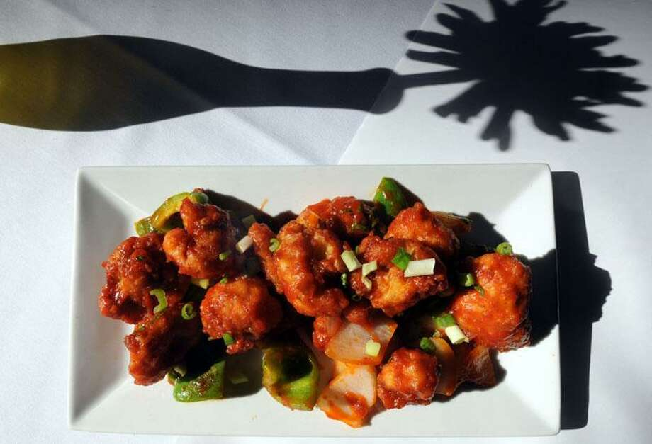 Red Lentil restaurant, New Haven: The Gobi Manchurian: Cauliflower tossed with Indian seasonings, breaded with chickpea flour, fried, and finished with sweet and spicy tomato sauce and fresh cilantro. Mara Lavitt/New Haven Register