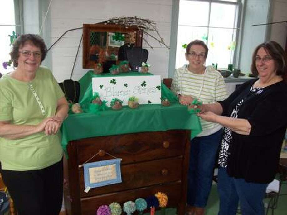 Photo Special to the Dispatch by MIKE JAQUAYSHartville Hollow sister-partners, from left, Molly Gray, Sheila Richer, and Elaine Ryan invite the public to come out for some artistry and history at their Fayetteville shop.