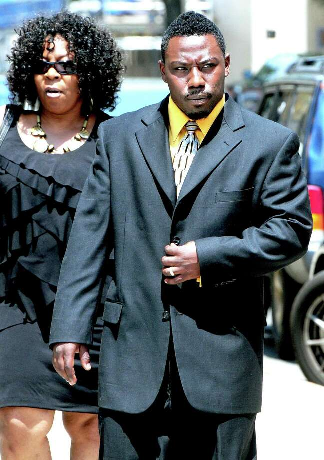 Marquis Morrison walks into Superior Court in New Haven on 7/7/2011.  At left is his mother, Linda Perry.Photo by Arnold Gold/New Haven Register     AG0418A