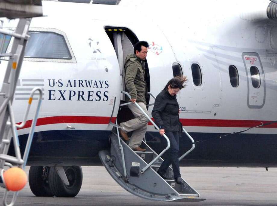 New Haven--Travelers disembark a US Airways Express flight at Tweed New Haven Regional Airport Thursday.  Photo by Brad Horrigan/New Haven Register-03.10.11.