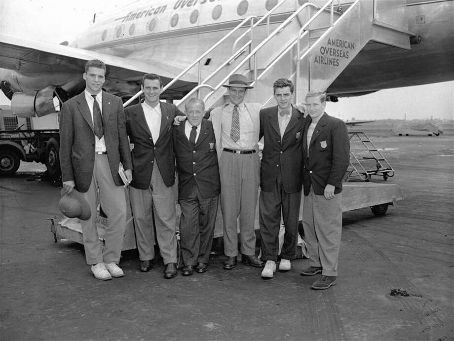 Gold medal winners of the US Summer Olympic swimming team s posing with the team's swimming coach at LaGuardia Field, NY, following their arrival from London, Aug. 21, 1948.  Left to right:  Allen Stack, Yale 100-meter backstroke winner; Walter Ris, University of Iowa, 100-meter free style; swimming coach Bob Kiphuth of Yale; Joe Verdeur, LaSalle College, Philadelphia, PA, 200-meter backstroke; Jimmy McLane, Andover Academy, 1,500-meter free style, and Bruce Harlan, Ohio State, springboard diving champion. (AP Photo) Photo: AP / 1948 AP