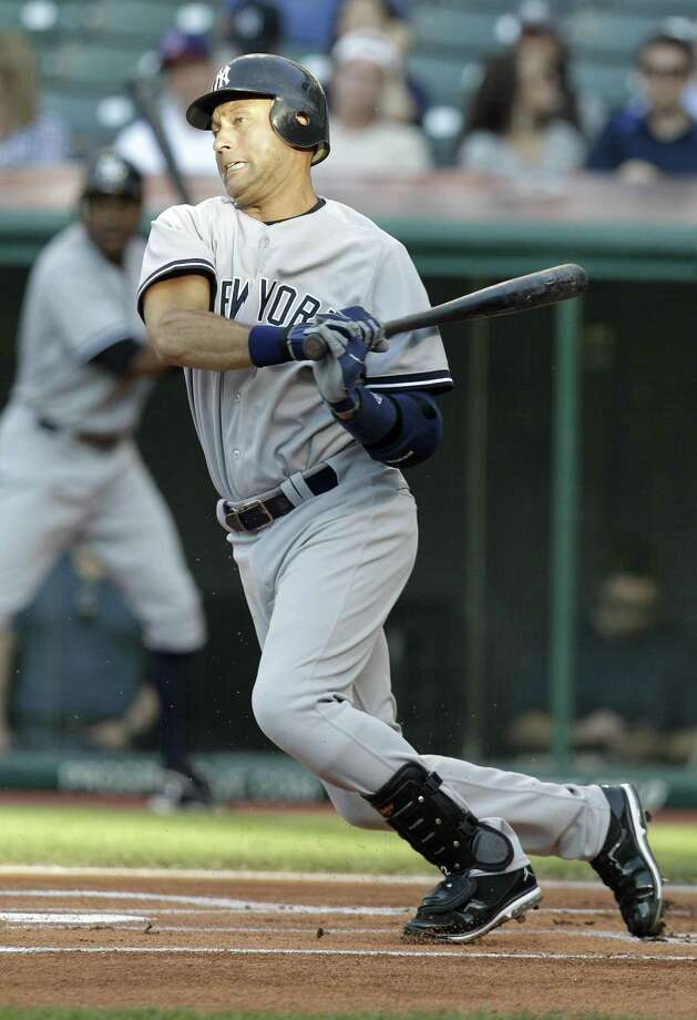 New York Yankees' Derek Jeter follows through on a single off Cleveland Indians starting pitcher Carlos Carrasco in the first inning of a baseball game, Tuesday, July 5, 2011, in Cleveland. (AP Photo/Tony Dejak) Photo: AP / AP 2010