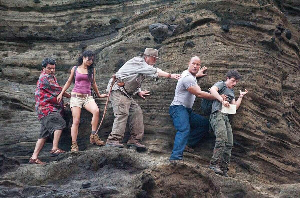 "Ron Phillips/Warner Bros. Pictures photo: Luis Guzman, left, Vanessa Hudgens, Michael Caine, Dwayne Johnson and Josh Hutcherson wander through ""Journey 2: The Mysterious Island."""