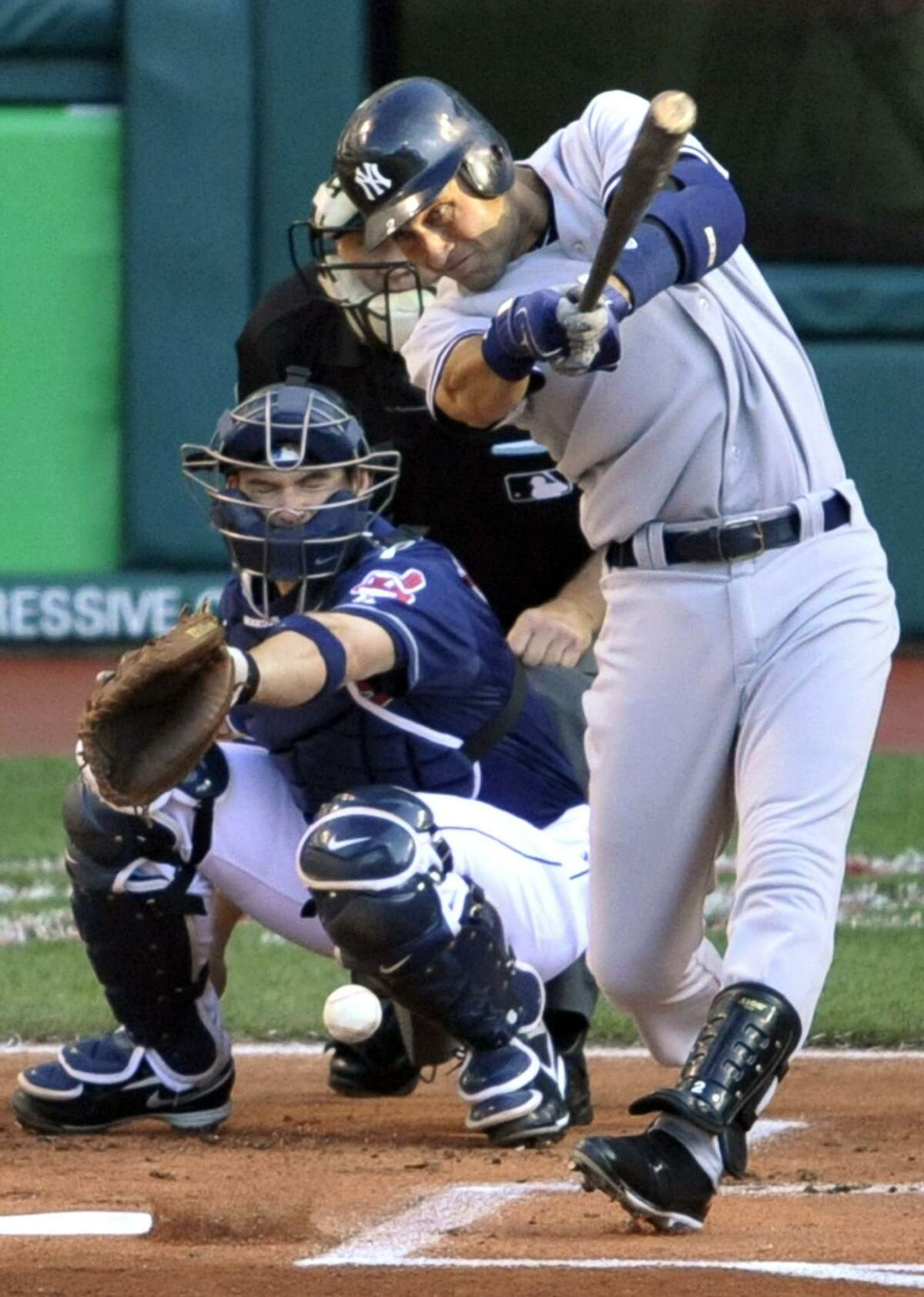 The Yankees' Derek Jeter hits a single off Cleveland Indians starting pitcher Carlos Carrasco in the first inning of Tuesday's game. Jeter finished with 2 hits, giving him 2,996, as the Yankees won 9-2. (AP Photo)