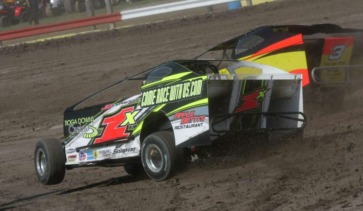 Submitted Photo Willy Decker passes Jeff Kotary to win a race at Utica-Rome Speedway Sunday, July 3, 2011.