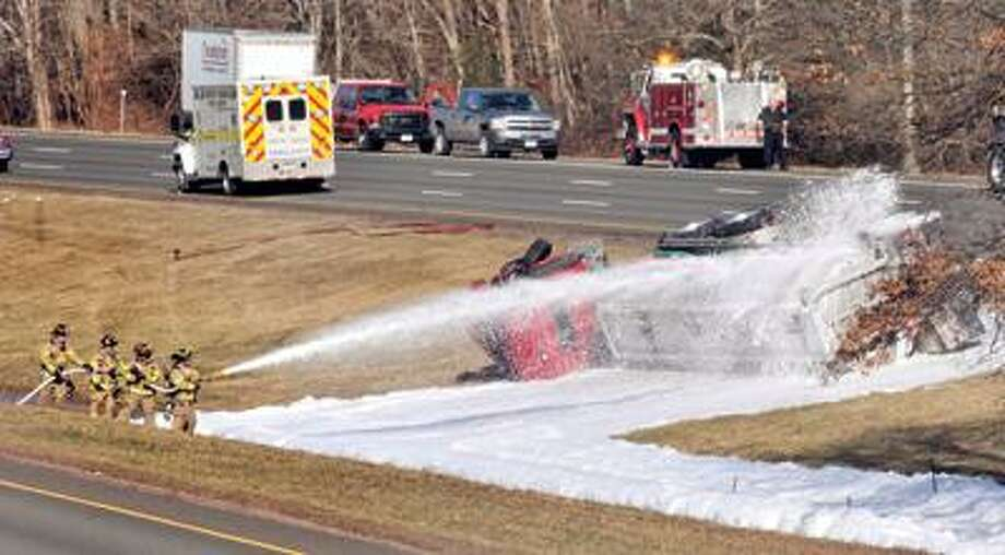 NORTH HAVEN--Firefighter spray foam on a gasoline tanker on 1-91 in North Haven.   Melanie Stengel/Register
