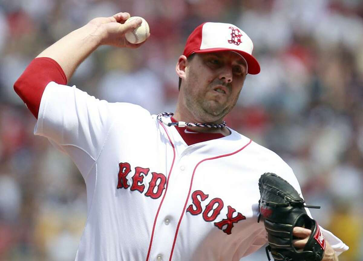 Boston Red Sox's John Lackey pitches in the first inning of a baseball game against the Toronto Blue Jays in Boston, Monday, July 4, 2011. (AP Photo/Michael Dwyer)