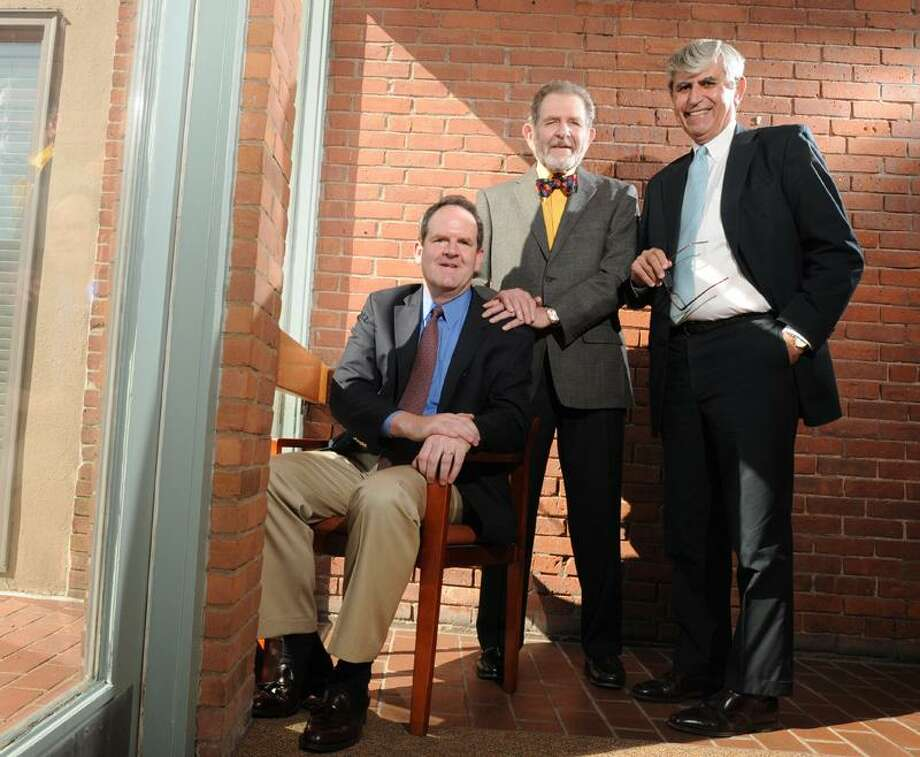 New Haven attorneys, from left, David T.  Grudberg, his father, Ira B. Grudberg, and William F. Dow III.  The prominent law firm of Jacobs, Grudberg, Belt, Dow and Katz has restructured. It is now Jacobs & Dow. Ira Grudberg is staying in the firm's Orange Street building, but in his own practice. David Grudberg is going to work at another New Haven firm. Peter Hvizdak/Register