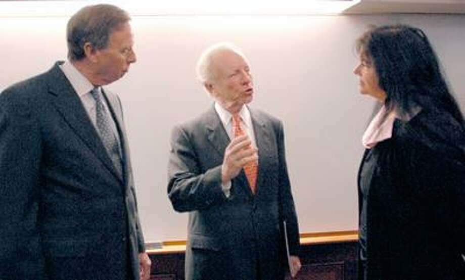 U.S. Senator Joe Lieberman (D-CT), center, talks with  Janet Bahgat, Quinnipiac University Adjunct Professor of English right, after speaking to Bahgat's Global Community Seminar about his recent travels to Tunisia and Egypt and the turmoil in the Middle East  3/7/11 at the university's Lender School of Business Center. Quinnipiac U. President John Lahey is at left.  (Photo by Peter Hvizdak/New Haven Register)