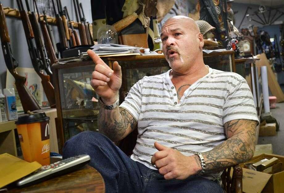 NEWHAVEN-Thomas Imperati, owner of The Hunters Shop, in Branford, talks about gun control.   Melanie Stengel/Register