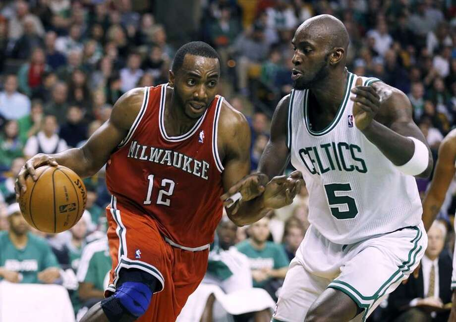Milwaukee Bucks' Luc Richard Mbah a Moute (12) drives past Boston Celtics' Kevin Garnett (5) in the fourth quarter of an NBA basketball game in Boston, Friday, Dec. 21, 2012. The Bucks won 99-94 in overtime. (AP Photo/Michael Dwyer) Photo: AP / AP