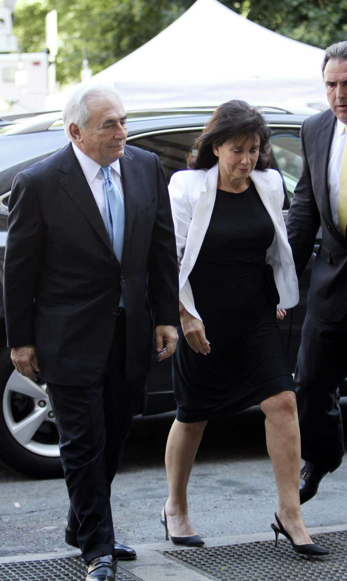 Dominque Strauss-Khan, left, arrives at New York Supreme court with his wife Anne Sinclair today in New York. Prosecutors have serious questions about the credibility of a hotel housekeeper who has accused Strauss-Kahn of sexual assault, and he is expected to have his strict bail conditions reduced Friday, according to people familiar with the case. (AP Photo/Mary Altaffer)