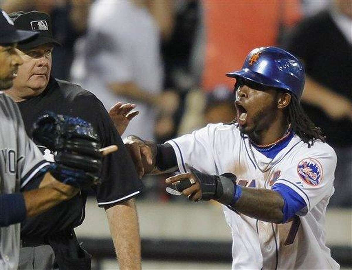 The Mets' Jose Reyes cannot believe umpire Jerry Lane called him out at third base as he tried to advance to third on a fly ball hit by Justin Turner in the seventh inning of Friday's game with the Yankees. The Mets wound up losing 5-1. (AP photo)