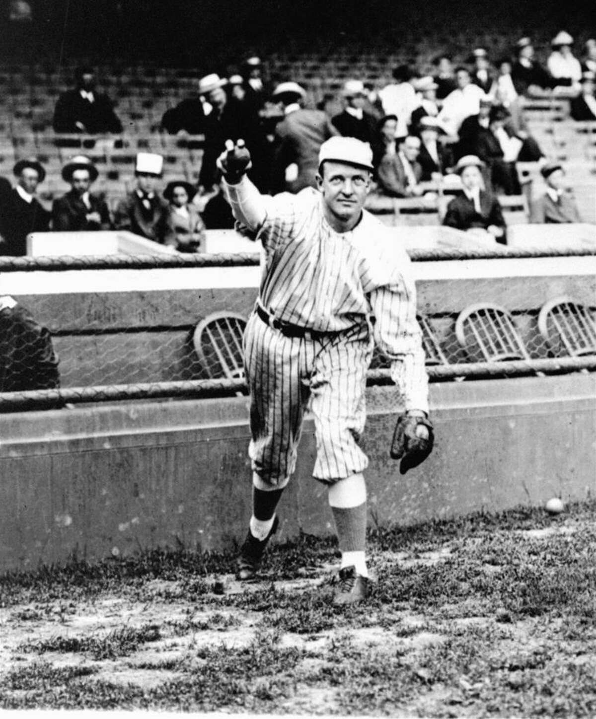 A posed action photo, circa 1910, of New York Giants' star pitcher, Christy Mathewson, who won 373 games during his illustrious career which spanned 17 years, from 1900 to 1916. (AP Photo)