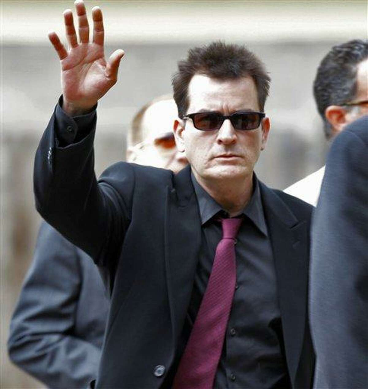 FILE - In a Aug. 2, 2010 file photo, Charlie Sheen waves as he arrives at the Pitkin County Courthouse in Aspen, Colo., for a hearing in his domestic abuse case. (AP Photo/Ed Andrieski, File)