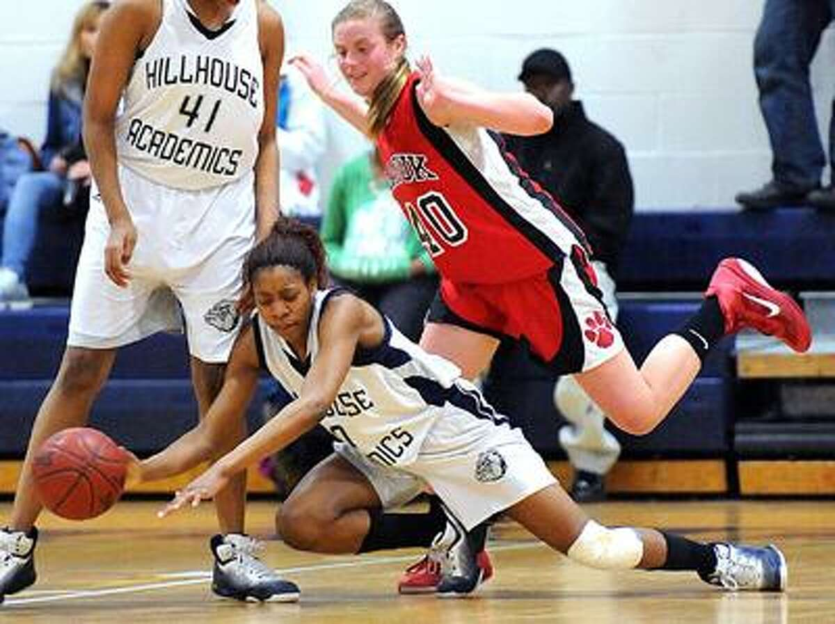 New Haven--Hillhouse's Colleene Smith goes to the floor for a loose ball against Masuk's Melissa Peet during the third period. Photo by Peter Casolino/New Haven Register03/07/11 Cas110307