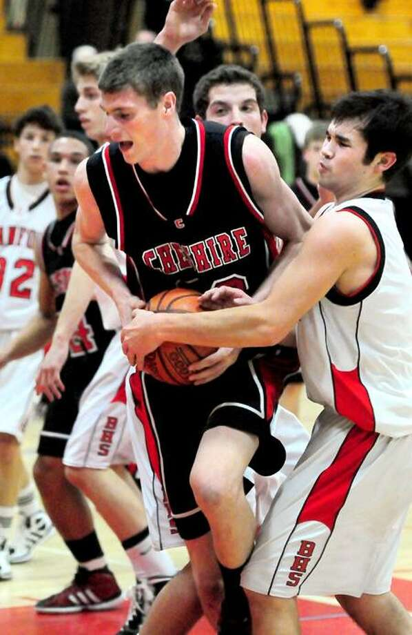 Cheshire's Nate Howard is tied up by Branford's Connor Moriarty in the first half. Photo by Arnold Gold/New Haven Register