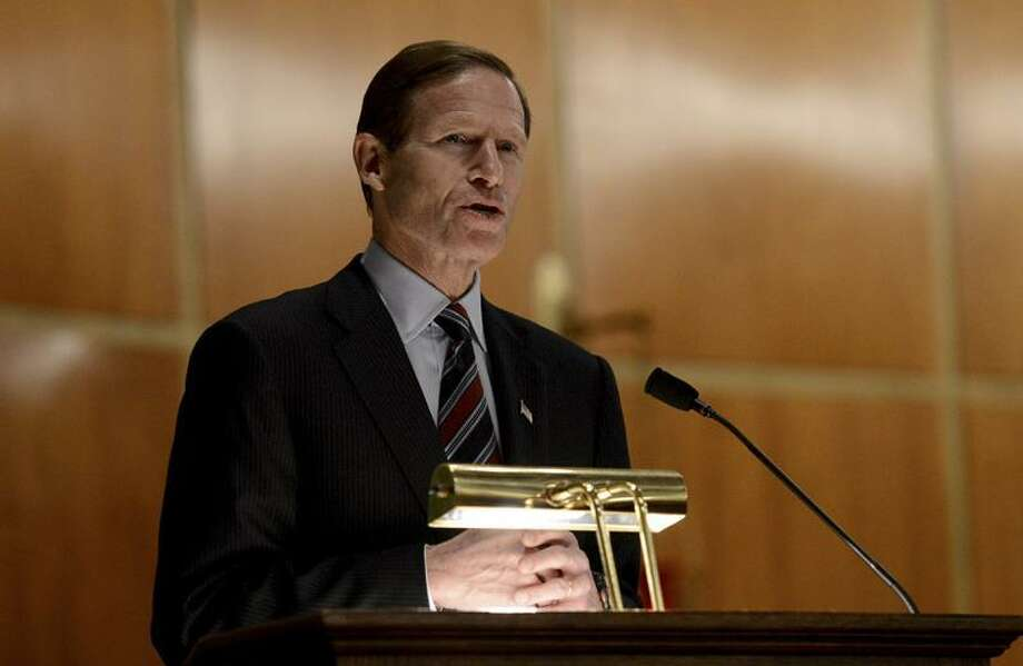 U.S. Sen. Richard Blumenthal speaks to mourners at a vigil service for victims of the Sandy Hook Elementary School shooting, at the St. Rose of Lima Roman Catholic Church in Newtown, Conn. Friday, Dec. 14, 2012. A man killed his mother at their home and then opened fire Friday inside the elementary school where she taught, massacring 26 people, including 20 children, as youngsters cowered in fear to the sound of gunshots reverberating through the building and screams echoing over the intercom (AP Photo/Andrew Gombert, Pool) Photo: AP / AP2012