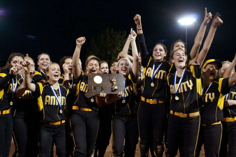 Amity celebrates winning the Class LL state softball championship last June, which ended up being the last game Bob Purcell would coach. He resigned after five seasons on Thursday.    Melanie Stengel/Register