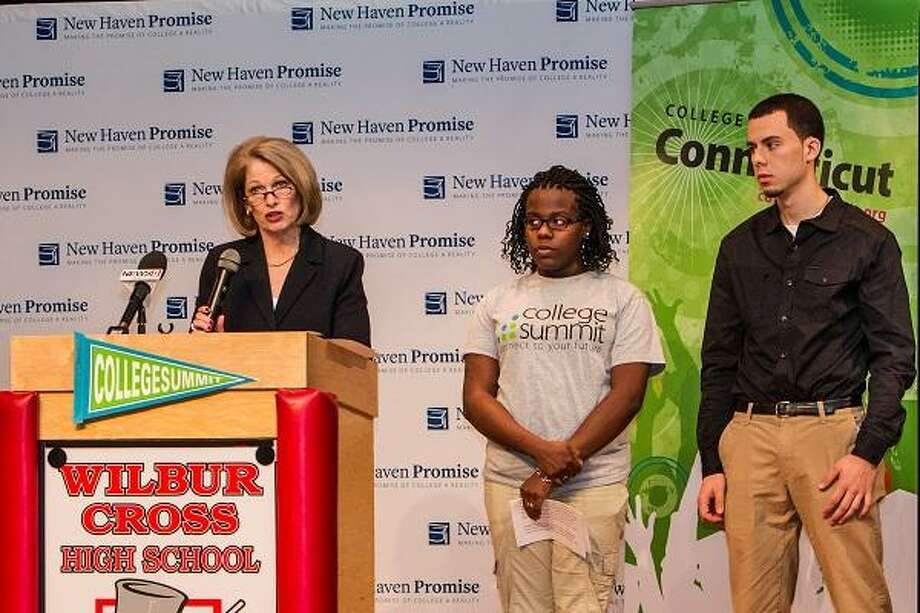 Yale-New Haven Hospital CEO Marna Borgstrom introduces Hillhouse High School graduate, New Haven Promise scholar and College Summit Peer Leader Evelyn Folson and Wilbur Cross graduate and Promise scholar James Doss-Golin. Contributed photo. / Chris Volpe Photography