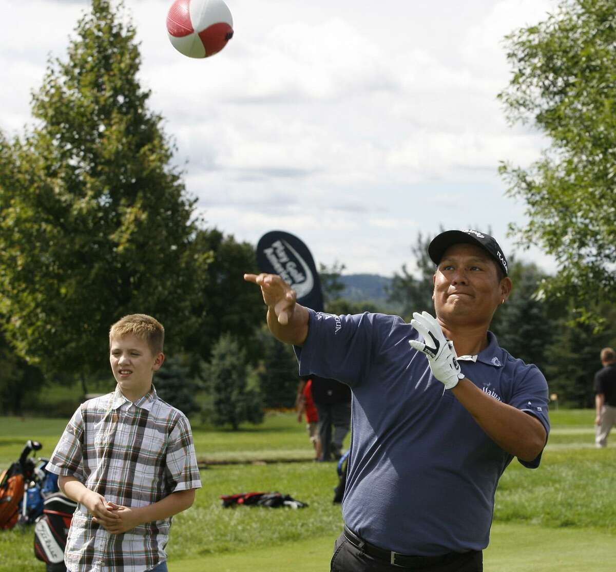 Dispatch Staff Photo by JOHN HAEGER twitter.com/oneidaphotoNotah Begay III throws the football around with youth during Play Golf Native America Day at Atunyote Golf Club in Vernon on Monday, Aug. 29, 2011.