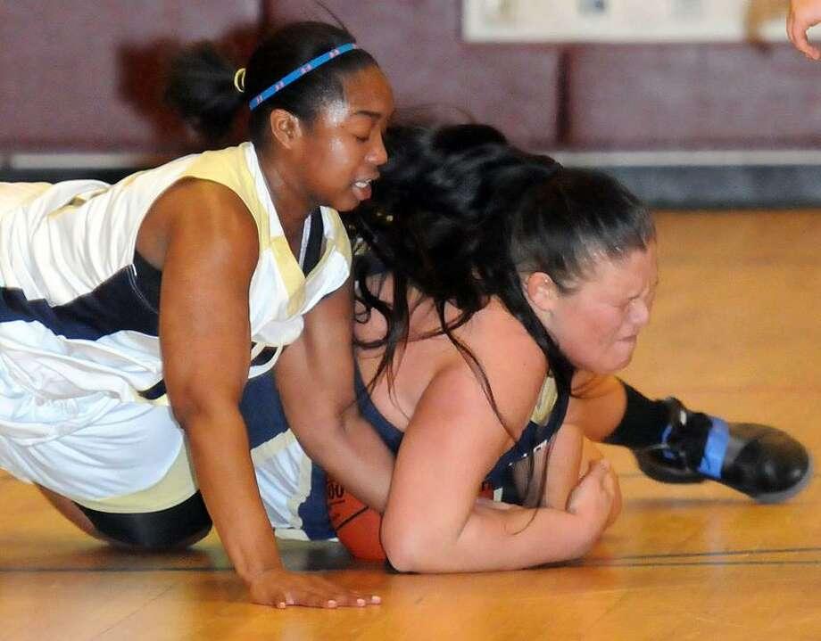 Haddam-Killingworth at Hyde (at Truman School), girls basketball. Hyde's Maya Eggleston left and HK's Tori Peterson. Mara Lavitt/New Haven Register12/20/12