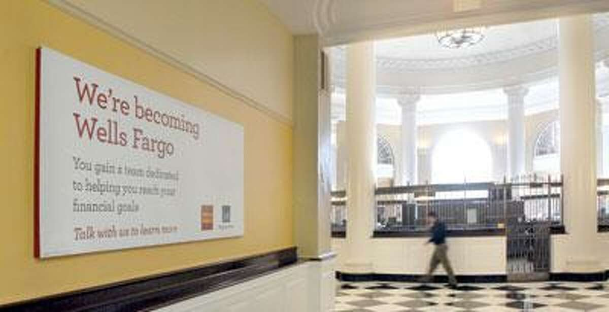 The view looking out to the rotunda of the Wachovia Bank at 157 Church St. in New Haven, which will soon switch over to the Wells Fargo name. The two banks began merging in 2008. (Peter Hvizdak/Register)