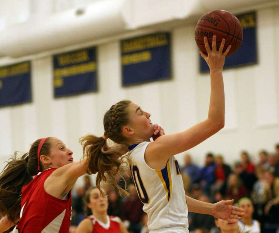 Mercy's Kendra Landy draws a first-half foul in Thursday's basketball game against Sacred Heart Academy.  Mercy won 55-40 to stay undefeated. Todd Kalif / a