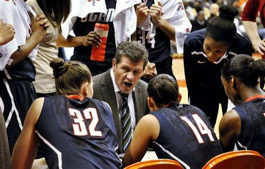 Connecticut coach Geno Auriemma talks with his players during a timeout against Syracuse in the second half of anNCAA college basketball game in Syracuse, N.Y., Wednesday, Jan. 25, 2012. Connecticut won 95-54. (AP Photo/Kevin Rivoli) Photo: ASSOCIATED PRESS / AP2012