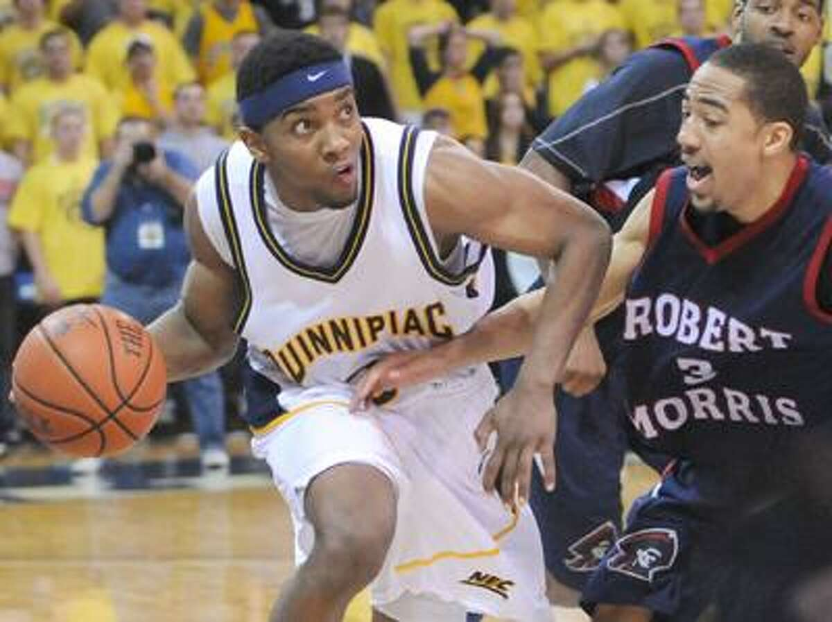 James Johnson of Quinnipiac University drives in vain as he looks to make the last shot against Coron Williams of Robert Morris University in a 64-62 losing effort during NEC basketball action Sunday 3/6/201 at the TD Bank Center in Hamden. Johnson took the last shot for for Quinnipac and missed. Photos by Peter Hvizdak / New Haven RegisterMarch5, 2011 ph2267
