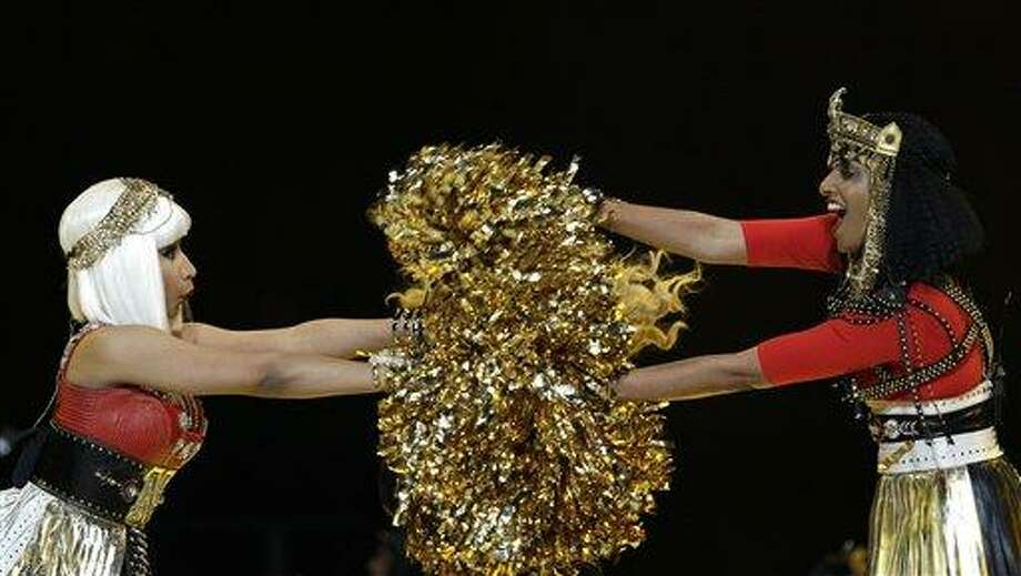 Nicki Minaj, left, and M.I.A. perform during halftime of the NFL Super Bowl XLVI football game between the New York Giants and the New England Patriots, Sunday, Feb. 5, 2012, in Indianapolis. (AP Photo/David J. Phillip) Photo: AP / AP