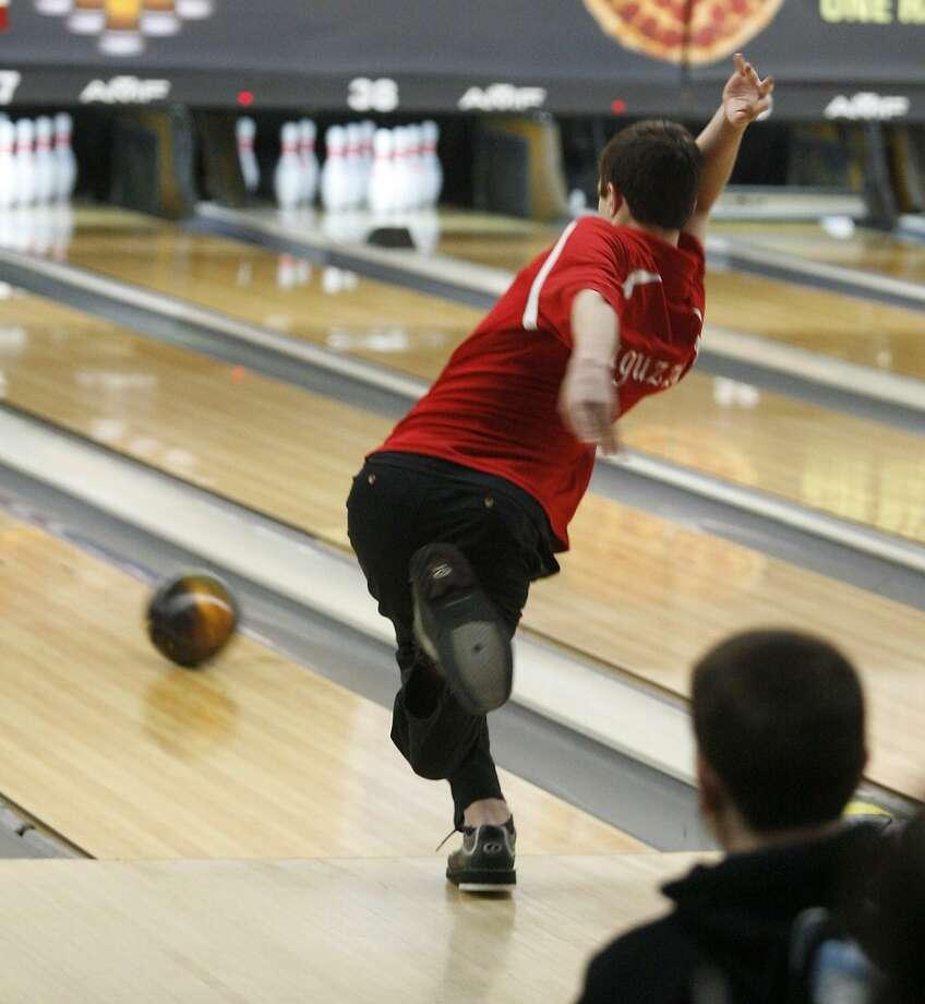 Dispatch Staff Photo by JOHN HAEGERVVS Collin Laguzza watches as his ball rolls for a strike in the opening frames of the second round of the NYSPHSAA State Championship in Syracuse on Saturday, March 5, 2011.