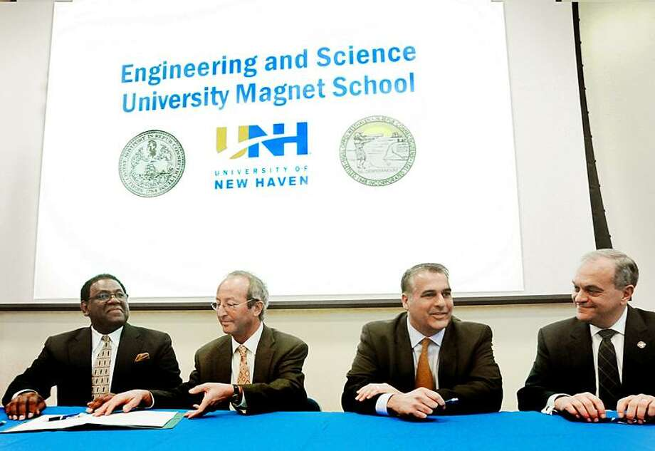 From left, New Haven School Superintendent Reginald Mayo, University of New Haven President Steven Kaplan, West Haven Mayor John Picard, and New Haven Mayor John DeStefano Jr. sign a joint agreement to establish a UNH scholarship program for Engineering and Science University Magnet School students. A new state-funded facility is to be constructed on or near the UNH campus. The signing took place at UNH.     Melanie Stengel/Register