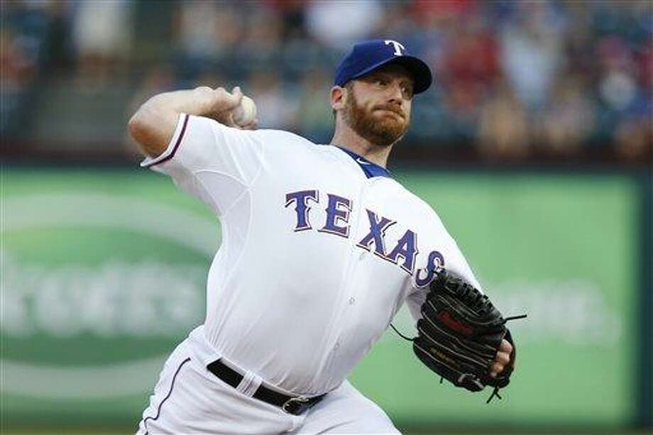 Texas Rangers starting pitcher Ryan Dempster during a baseball game against the Baltimore Orioles on Monday, Aug. 20, 2012, in Arlington, Texas. The Rangers won 5-1. (AP Photo/Jim Cowsert) Photo: ASSOCIATED PRESS / AP2012