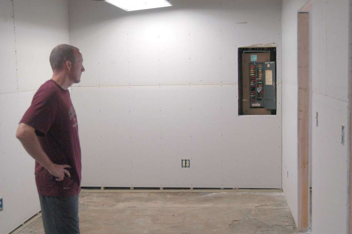 Dispatch Staff Photo by DAVID M. JOHNSON Boy's director of coaching Paul Stinson shows off the new office space where club president Corinne Banker and others will have desks. The renovation is being done with volunteer labor.