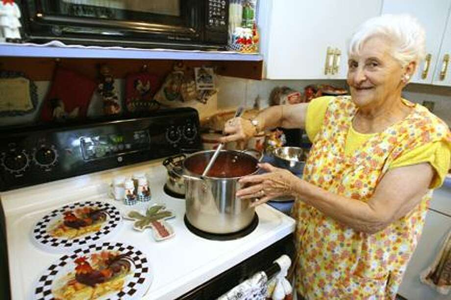 """Dispatch Staff Photo by JOHN HAEGER <a href=""""http://twitter.com/oneidaphoto"""">twitter.com/oneidaphoto</a>  Mary Alessi cooks in her home in Verona."""