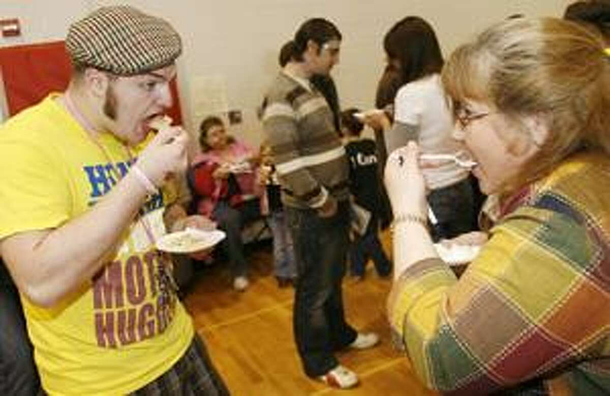 Photo by JOHN HAEGER Daryl Day and Kim Hunn sample pies during the people's choice pie judging contest at the sixth annual Community Showcase held at the Chittenango High School last year. This year's showcase runs from 11 a.m. to 4 p.m. today at the high school.