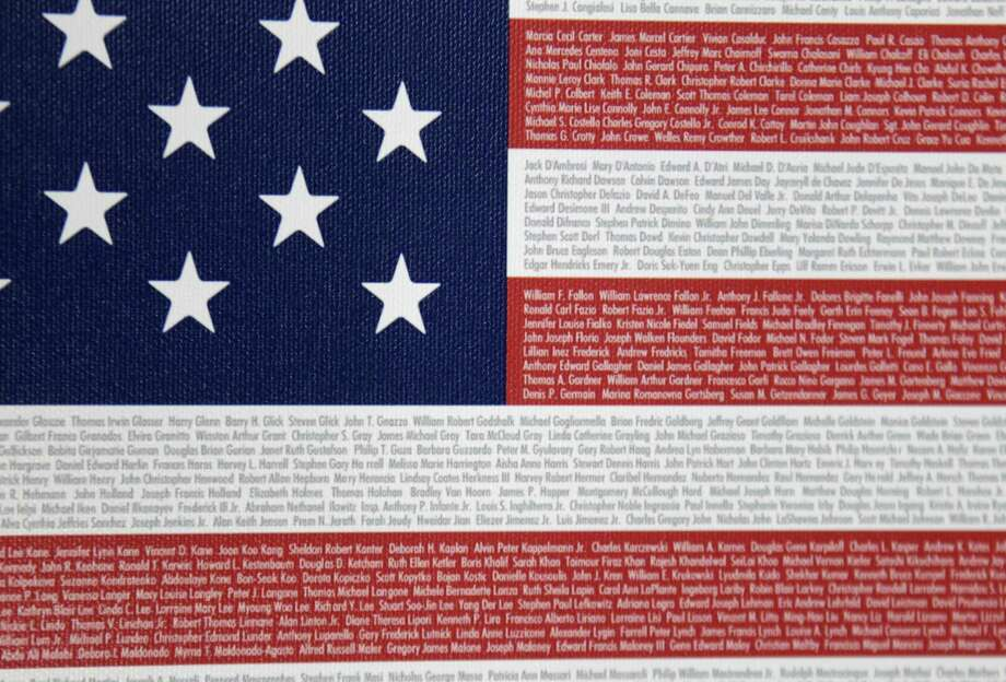 "This 9-11 memorial ""Flag of Honor"" was designed by John Michelotti, whose warehouse is in Greenwich, Conn. At first glance, the Flag of Honor/Flag of Heroes Project looks like any other charity doing philanthropy in the name of 9/11. But people who have bought one of its flags would likely be surprised to learn that nearly all the proceeds have gone to the charity founder's for-profit flag company, not 9/11 victims.  Associated Press Photo: ASSOCIATED PRESS / AP2011"