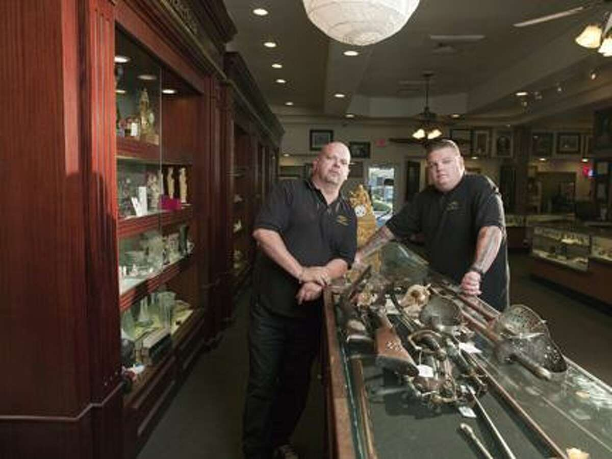 Photo Courtesy The History Channel Rick Harrison and his son Corey at the Gold and Silver Pawn Shop in Las Vegas, Nev. The Pawn Stars will be at the Turning Stone Event Center on Saturday, Aug. 27, 2011 as part of their Gold and Silver Road Show.