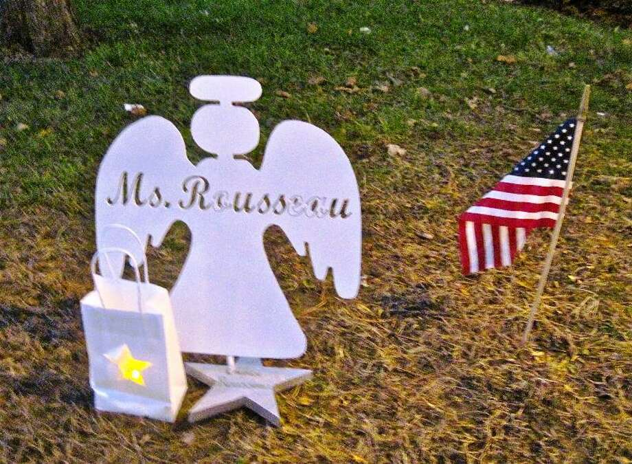 This is one of the 26 angels created by manufacturing technology students at Emmett O'Brien Technical High School in Ansonia. It is in memory of Lauren Rousseau, 30, one of the six educators murdered Friday at Sandy Hook Elementary School. The angels are displayed on the grass in front of the school. Patricia Villers/Register