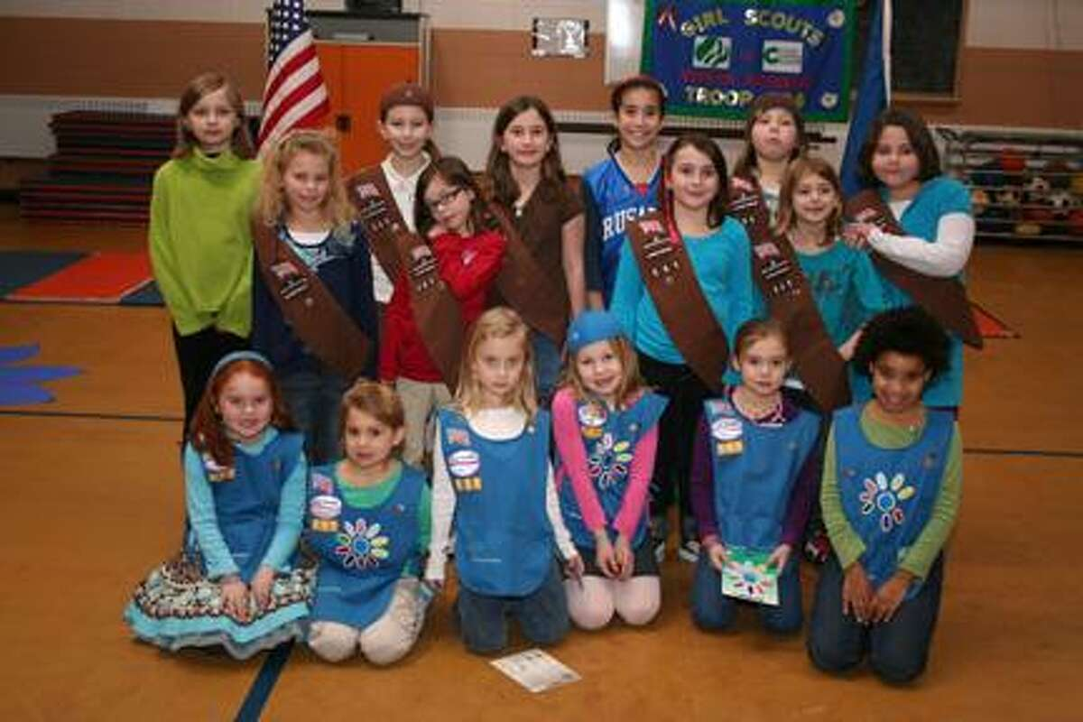 SUBMITTED PHOTO Members of Girls Scout Troop 20561 pose for a picture at their annual awards ceremony.