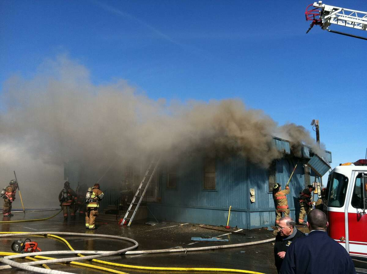 Firefighters battle the blaze. Contributed photo by Sean Tomaso.