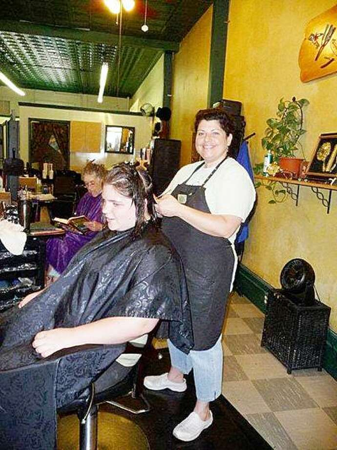 SUBMITTED PHOTO Annie Blowers gives a hair cut to Denise Wallis.