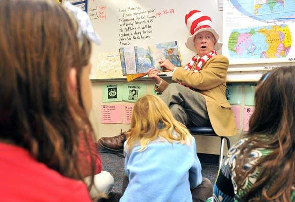 Madison First Selectman Fillmore McPherson reads to third graders at Island Avenue Elementary School Wednesday as part of the Dr. Seuss birthday reading celebration. (Photo by Brad Horrigan/New Haven Register)